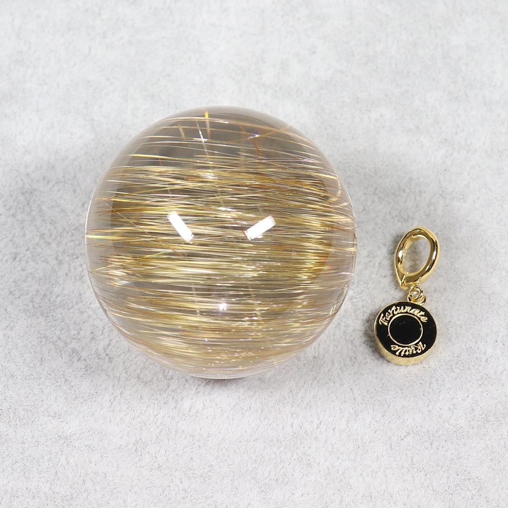 プレミアムイエローゴールドキャツアイルチルクォーツ(水晶ベース) 42.3ミリ玉の画像
